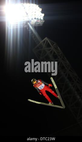 Krasnaya Polyana, Russia. 14th Feb, 2014. Kamil Stoch of Poland in action during a trial jump in RusSki Gorki Jumping - Stock Photo