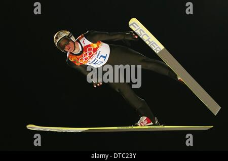 Krasnaya Polyana, Russia. 14th Feb, 2014. Thomas Morgenstern of Austria in action during a trial jump in RusSki - Stock Photo