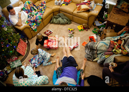 Young brothers opening gifts on xmas day - Stock Photo
