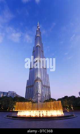 Fountain in front of tallest building Burj Khalifa in Dubai - Stock Photo