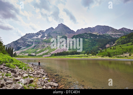 Mid adult woman paddling in mountain river, Aspen, Colorado, USA