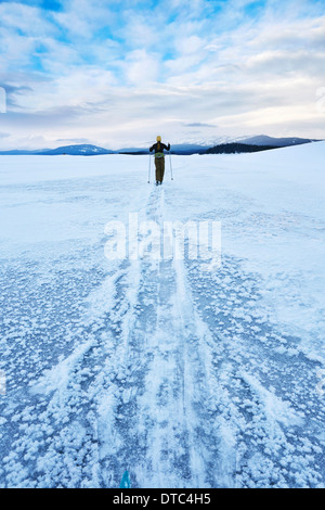 Mid adult woman skiing across vast landscape, Colter Bay, Wyoming, USA - Stock Photo