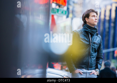 Young male tourist exploring streets, New York City, USA