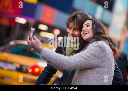 Young couple taking a selfie, New York City, USA - Stock Photo