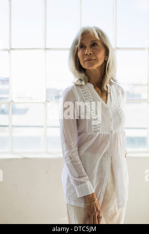 Portrait of senior woman in apartment - Stock Photo
