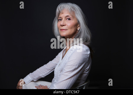 Studio portrait of aloof senior woman - Stock Photo