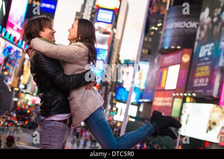 Young tourist couple embracing, New York City, USA - Stock Photo