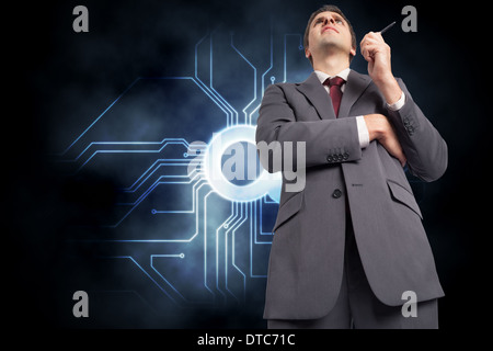 Composite image of thoughtful businessman holding pen - Stock Photo