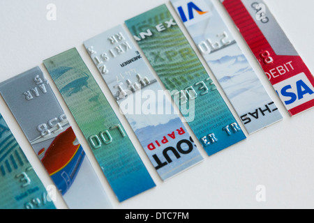 Arranged photos of various U.S. credit cards from Visa, MasterCard and American Express - Stock Photo