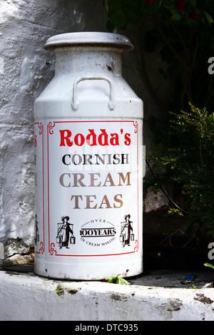 Old fashioned Rodda's milk churn for clotted cream for Cornish cream teas, Fowey, Cornwall , England - Stock Photo