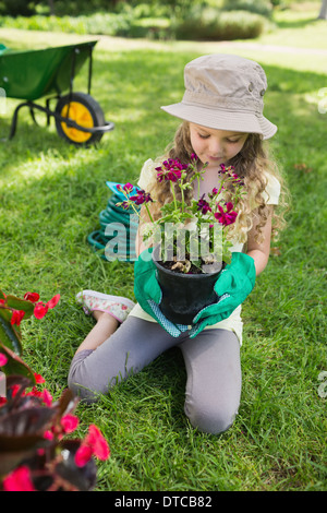 Little girl engaged in gardening - Stock Photo