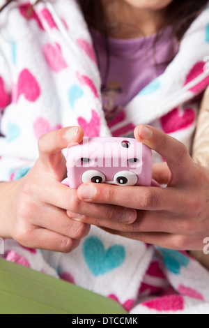 Teenage girl on her smart phone-close-up - Stock Photo