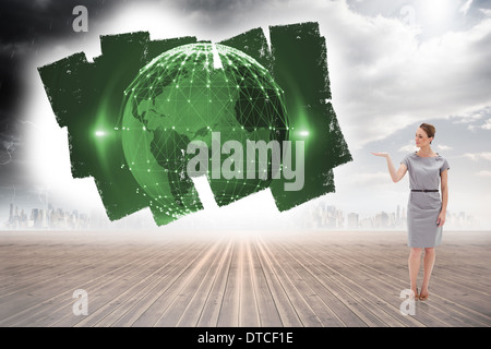 Composite image of woman in a dress holding her hand up - Stock Photo