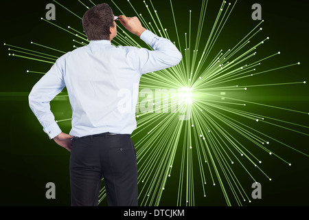 Composite image of thinking businessman tilting glasses - Stock Photo