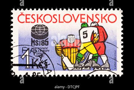 Postage stamp from Czechoslovakia depicting hockey players. - Stock Photo