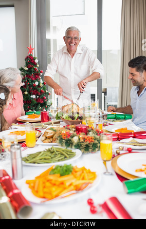 A Father Serving Christmas Dinner To His Daughter Stock