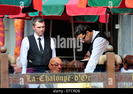 Brussels, Belgium. Waiters at cafe in the Grand Place - Stock Photo