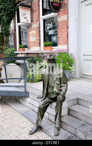 Bronze Statue Of Man Sitting On A Bench Along The