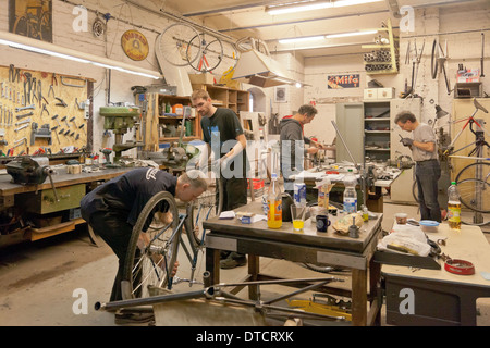 berlin germany bicycle frame building in the workshop of ostrad stock photo