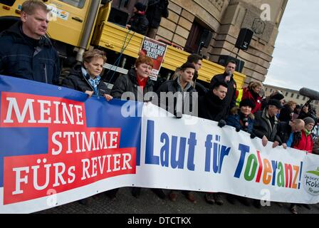 Cottbus, Germany. 15th Feb, 2014. People hold a banner reading 'My vote for the area - Loud for tolerance!' demonstrate - Stock Photo