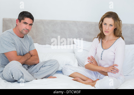 Unhappy couple in bed - Stock Photo