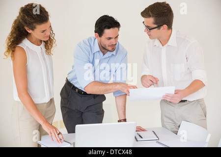 Business people discussing over document - Stock Photo