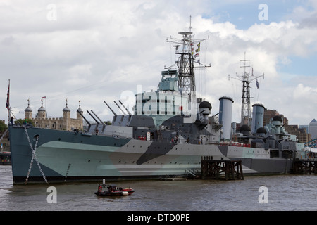 This image shows HMS Belfast, a decommissioned Royal Navy light cruiser which is permanently moored in London, England. - Stock Photo