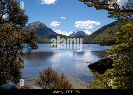 Lake Sylvan with Forbes Mountains in distance Mount Aspiring National Park, near Glenorchy, South Island, New Zealand - Stock Photo