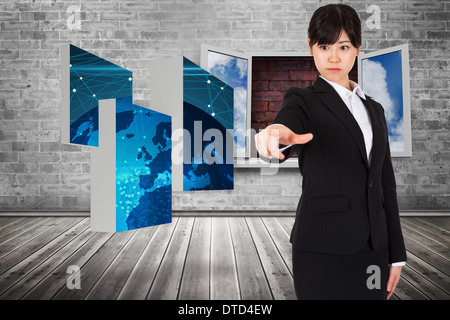 Composite image of focused businesswoman pointing - Stock Photo