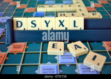 Scrabble board and tiles, mis-spelling the word dyslexia