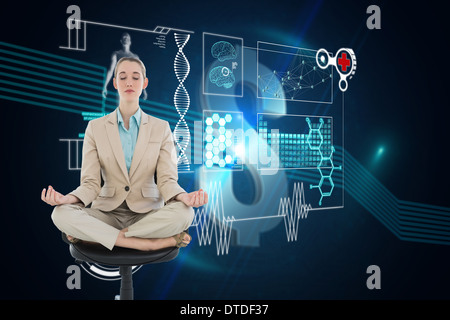 Composite image of peaceful chic businesswoman sitting in lotus position on swivel chair - Stock Photo