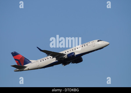 Operated by Compass Airlines, an Embraer 175 regional airliner in Delta Connection livery takes off from Vancouver - Stock Photo