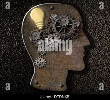 Brain mechanism made from metal cogs and gear with idea bulb lamp - Stock Photo