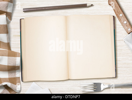 blank cooking recipe notes or book with pencil on kitchen table - Stock Photo