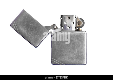 Used vintage metal lighter isolated on white background - Stock Photo
