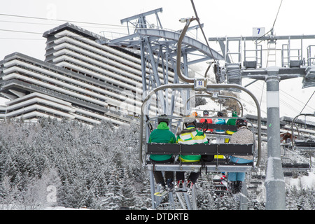 Skiers in a chairlift in Les Menuires, Trois Vallees, France - Stock Photo