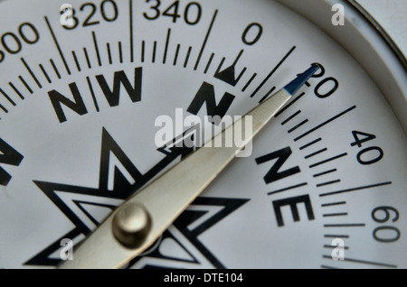 Finding your direction / Survival skills concept - Close-up of compass rose and magnetic bearing. Concept navigation. - Stock Photo