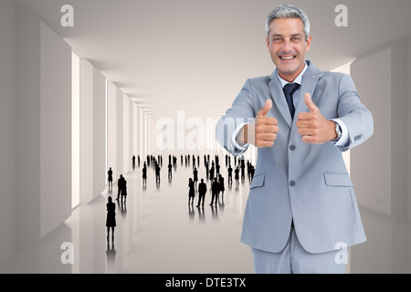 Composite image of positive handsome businessman - Stock Photo