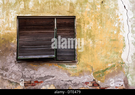 Old window on obsolete grunge cracked wall - Stock Photo