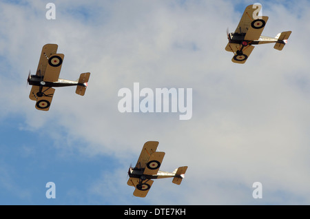 A 'Vic' of three First World War replica aircraft flying as if off to patrol over the lines. Period 1917-1918 scenario - Stock Photo