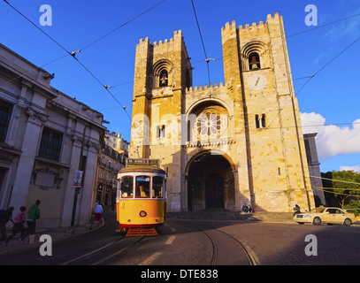 Traditional Yellow Tram in front of the Cathedral of Lisbon, Portugal - Stock Photo