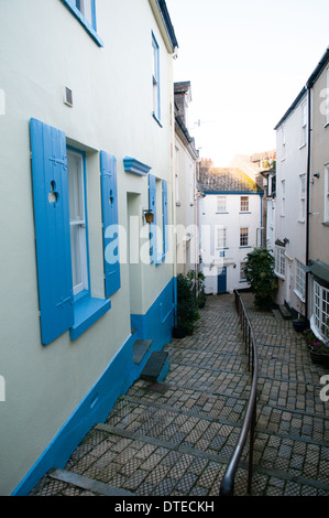 Pretty colourful houses along narrow  winding steps in a cobbled lane in the quaint old town area of historic Dartmouth in Devon, UK