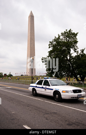 Washington Monument and Police car in Washington DC - Stock Photo