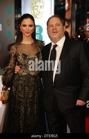 London, Great Britain. 16th Feb, 2014. US film producer Harvey Weinstein and British fashion designer Georgina Chapman - Stock Photo