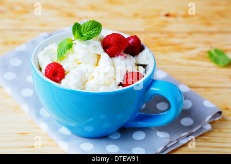 cottage cheese with fresh raspberries, food closeup - Stock Photo