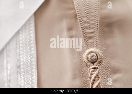 Detailed stitching of Kandura, the ankle-length garment - Stock Photo