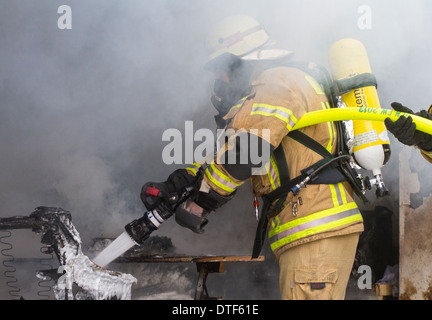 Berlin, Germany, fire in Loesch attack on a Branduebungscontainer - Stock Photo