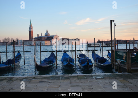 Venice, Italy, Against a background of St Giorgios, Gondolas lie still at the end of the day. It is a scene that typifies Venice