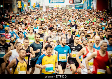Barcelona, Spain. 16th Feb 2014.  : Roughly 14.000 runners start into the 24th edition of the Barcelona Half Marathon - Stock Photo