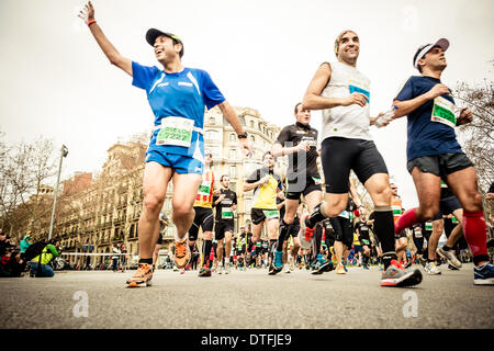 Barcelona, Spain. 16th Feb 2014.  : Roughly 14.000 runners compete during the 24th edition of Barcelona's half marathon - Stock Photo